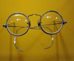 """John Lennon's round-lens """"Windsor"""" spectacles on display in a new exhibit at the Rock & Roll Hall of Fame Annex NYC May 11, 2009 entitiled """" John Lennon: The New York City Years."""" Lennon, one of the founders of the Beatles, was shot and killed outside his NYC apartment building on December 8, 1980. AFP PHOTO/ TIMOTHY A. CLARY"""